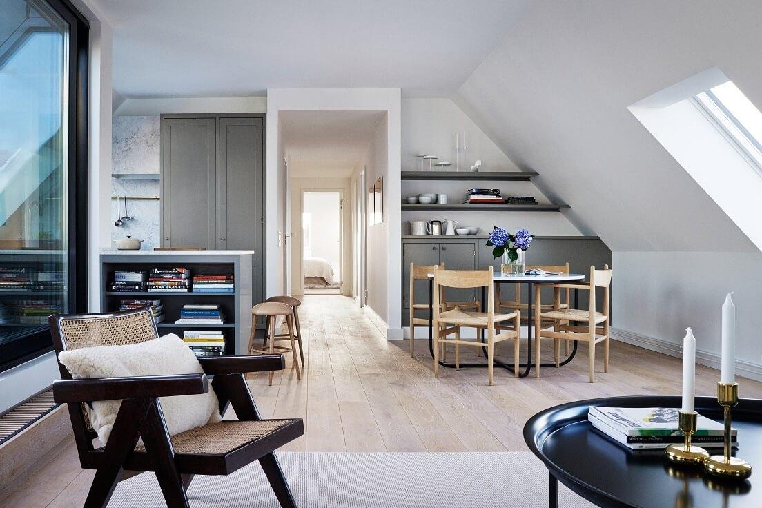 Salon z kuchnią i jadalnią w minimalistycznej aranżacji