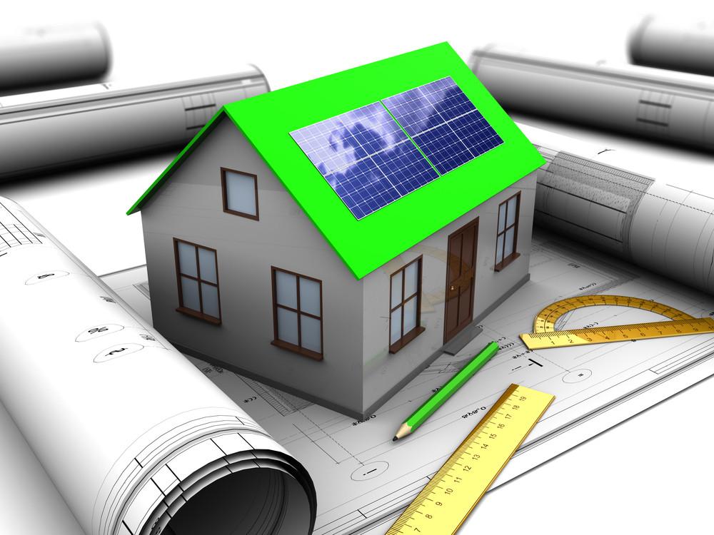 Model domu energooszczędnego z panelami fotowoltaicznymi
